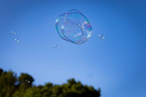 Image of a large soap bubble floating in the sky