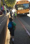 RVC Students greet the yellow school bus in Downtown Fairfax