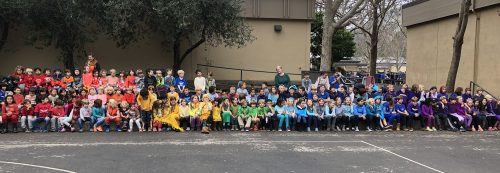 Ross Valley Charter - RVC elementary school students grades Transitional Kindergarten through fifth dress in bright colors and arrange themselves to form a rainbow