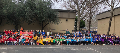 Ross Valley Charter Students celebrate student body diversity and inclusion of all peoples by dressing in bright colors and arranging themselves to form a color spectrum.