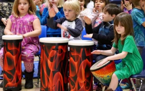RVC students take an expedition into music playing the bongos and percussion instruments