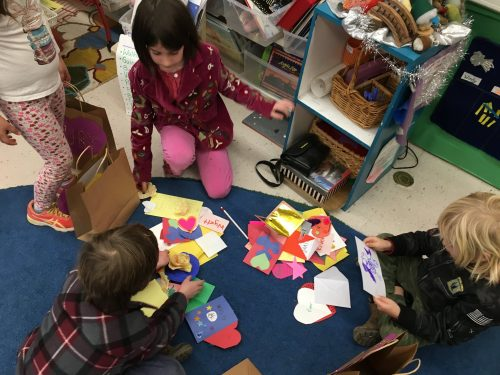 Transitional Kindergarteners, Kindergarteners, and First graders create valentines for friends