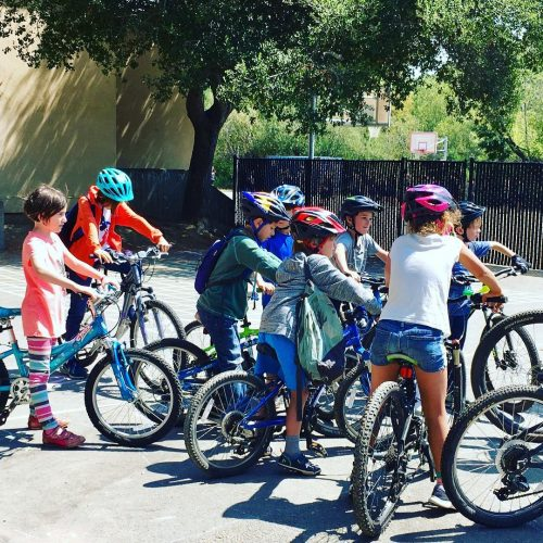 RVC students on bicycles for after-school mountain biking