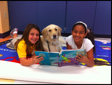 Ross Valley Charter Students reading to a golden retriever