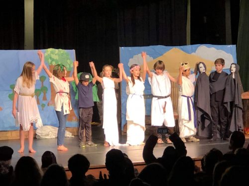 Ross Valley Charter Students on stage, performing a play on Greek Myths as part of their academic exploration.