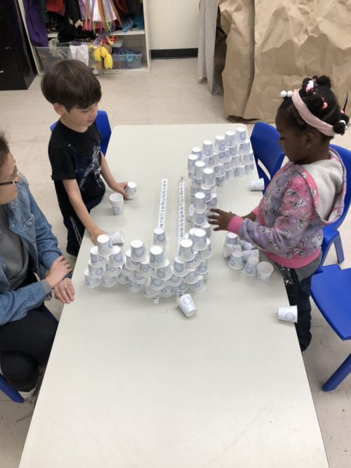 Students use paper cups to develop math skills