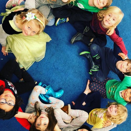 A circle of transitional kindergarten and kindergarten students at Ross Valley