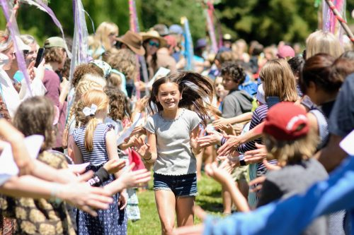 Ross Valley Elementary students high five in celebration of fifth-grade graduation