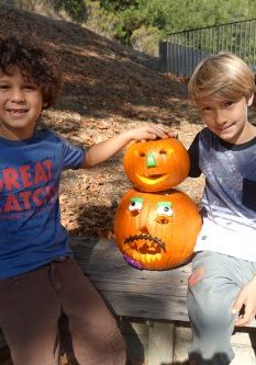 Ross Valley Charter elementary school buddies proudly display their carved pumpkins